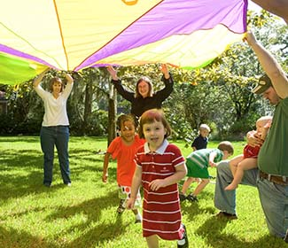 kids playing under parachute