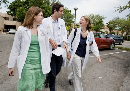 Doctors walk to clinic center