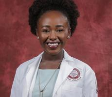 Chege is college's 11th NHSC scholar