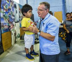 Dr. George Rust talks with a young patient in Quincy, Florida. Photo Credit: Colin Hackley