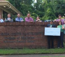 The Class of 2020 pictured in front of our campus with our Dean Dr. Rahangdale, Dr. Christie Alexander, and Executive Director of Capital Medical Society, Pam Irwin, holding a check for $2,000