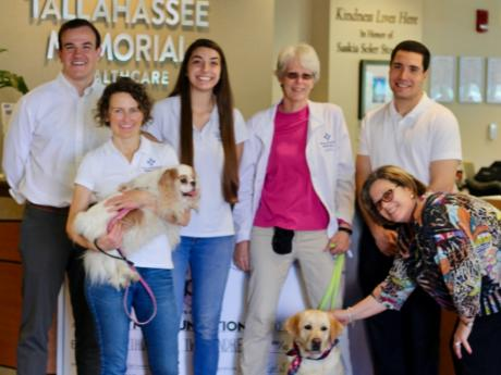 Med Students participating in animal therapy program