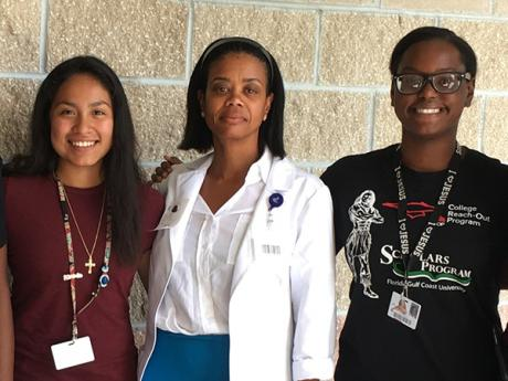 SSTRIDE students Britney Garcia and Ruth Bellevue with Dr. Martine Woodley (pharmacist at Healthcare Network of Southwest Florida).
