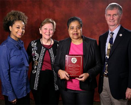 Joedrecka Brown Speights, Helen Livingston, Thesla Berne-Anderson and College of Medicine Dean John P. Fogarty
